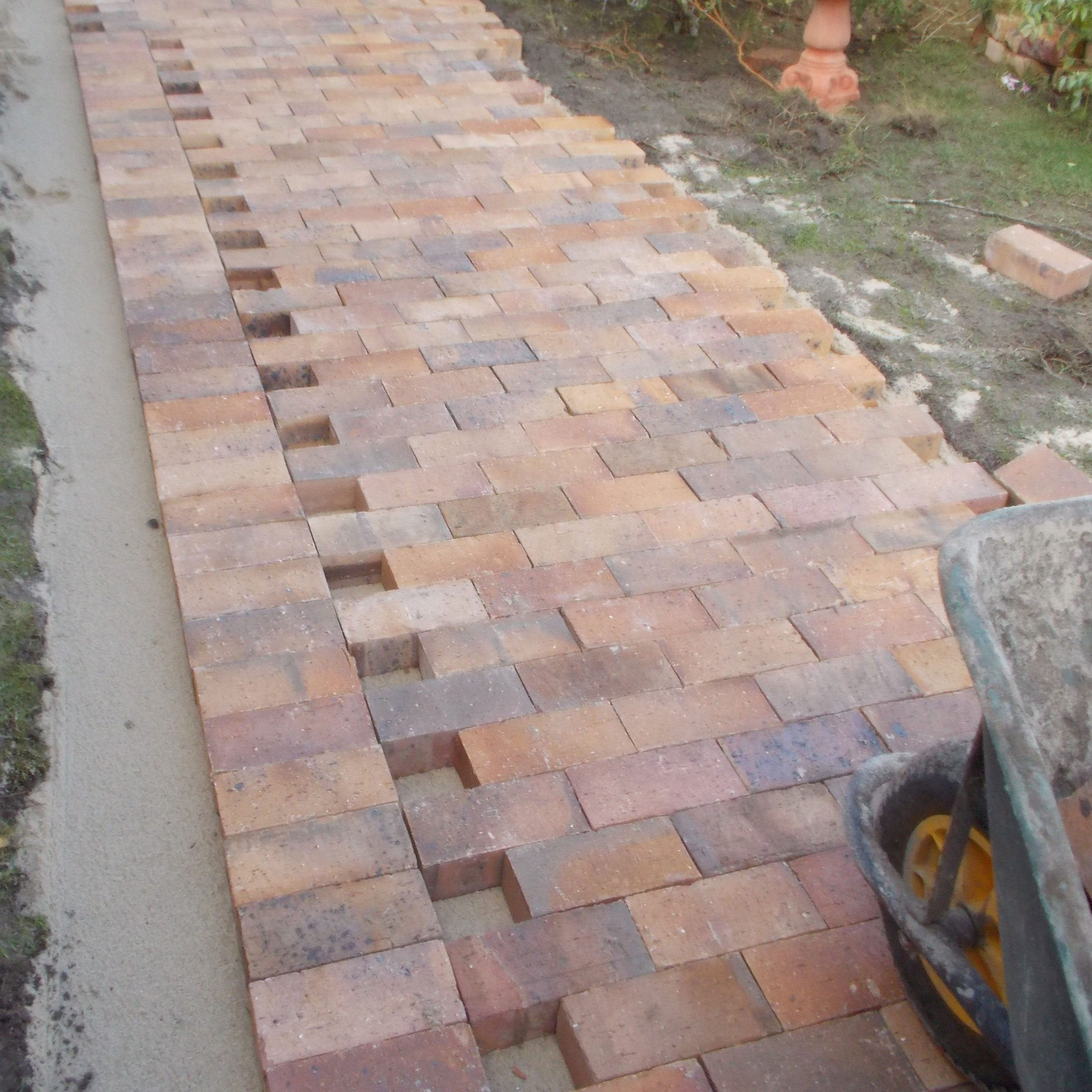 Lay some brick paving in your garden 17